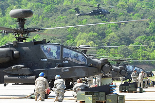 Soldiers from 4th Attack Reconnaissance Battalion, 2nd Combat Aviation Brigade, soldiers participate in an aerial gunnery on May 15, 2013, north of Seoul. Crews had to qualify on their weapon systems from their UH-60 Blackhawk helicopters. (U.S. Army photo by Staff Sgt. Aaron Duncan, 2nd CAB PAO)