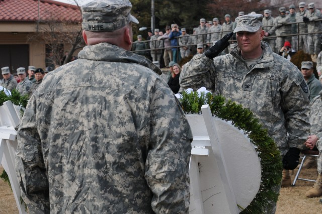 Col. Joseph P. Gleichenhaus (right), commander of 3rd Battlefield Coordination Command-Korea, salutes after placing a wreath, during the anniversary ceremony commemorating the 27th Infantry Regiment Company E's bayonet charge during the Battle of Hill 180, Feb. 7, 2014.