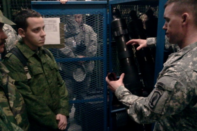 Russian army 1st Lt. Konstantin Shopovalov, a Vienna Document evaluator, examines a battalion arm rooms facilities with 1st Lt. John Skelly, a paratrooper with the 1st Battalion, 503rd Infantry Regiment, 173rd Infantry Brigade Combat Team (Airborne), as part of the brigade's evaluation held in Vicenza, Italy, Jan 28, 2014.