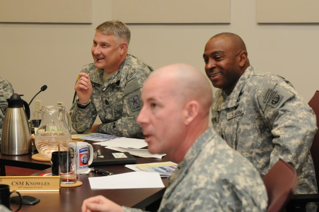 Sgt. Maj. of the Army Raymond Chandler III receives a briefing hosted by Command Sgt. Maj. Lamarquis Knowles, the senior enlisted advisor for the 82nd Airborne Division, during a visit to Fort Bragg, N.C., Feb. 10, 2014. During his visit, Chandler briefed senior enlisted leaders on the challenges that face the Army profession and the importance of engaged leadership and discipline within the force.