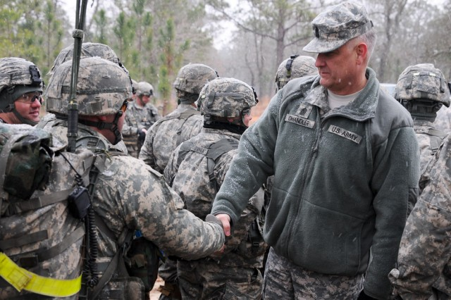Sgt. Maj. of the Army Raymond F. Chandler III shakes hands with infantrymen assigned to C Company, 2nd Battalion, 501st Parachute Infantry Regiment, 1st Brigade Combat Team, 82nd Airborne Division, during C Company's communications exercise, Feb. 11, 2014. During his visit to Fort Bragg, N.C., Chandler observed the paratroopers' training, discussed current Army issues and thanked the troopers for their hard work and service.
