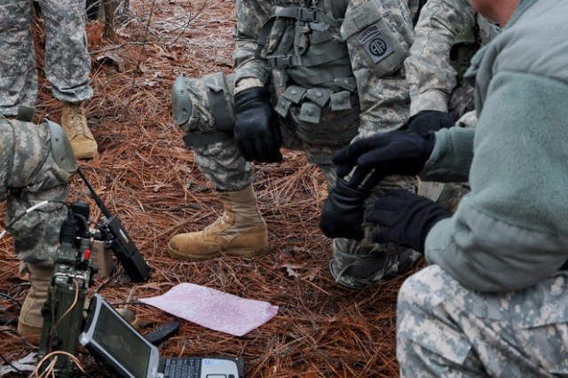 Sgt. Maj. of the Army Raymond F. Chandler III speaks with infantrymen assigned to C Company, 2nd Battalion, 501st Parachute Infantry Regiment, 1st Brigade Combat Team, 82nd Airborne Division, during C Company's communications exercise, Feb. 11, 2014. During his visit to Fort Bragg, N.C., Chandler observed the paratroopers' training, discussed current Army issues and thanked the troopers for their hard work and service.