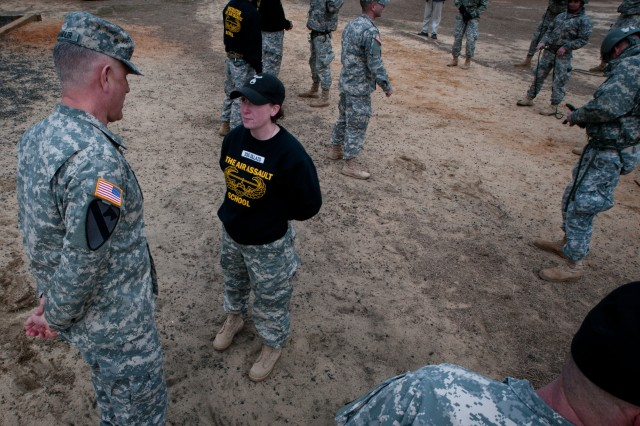 Sgt. Maj. of the Army Raymond F. Chandler III (left) discusses leadership with Staff Sgt. Joni Collazo (right), an instructor with the Fort Bragg, N.C., Air Assault School. Minute attention to detail is a corner stone stressed by the instructors at the school through hands-on, close interaction with the students. Chandler stressed throughout his visit that dynamic and involved leadership at all levels will be the key to success for the Army of tomorrow.