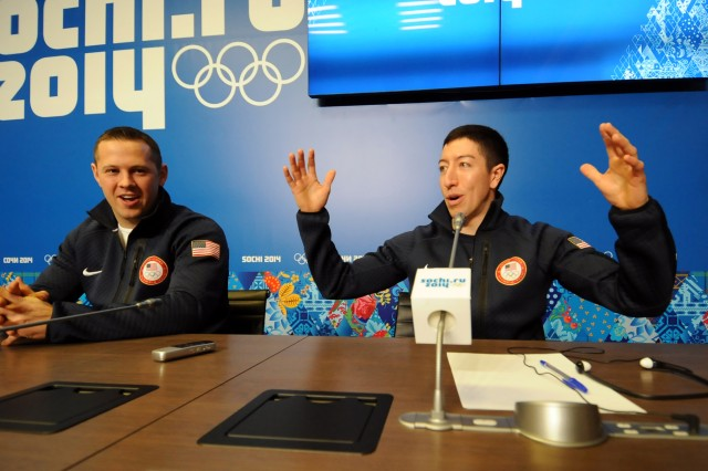 Sgt. Matt Mortensen (left) of the U.S. Army World Class Athlete Program listens to WCAP teammate Sgt. Preston Griffall (right) during a Team USA luge doubles press conference ,Feb. 10, at Gorki Media Center in Esto-Sadok, Russia.