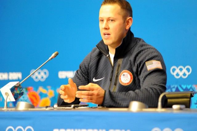 U.S. Army World Class Athlete Program Olympian, Sgt. Matt Mortensen, explains his military role during a Team USA luge doubles press conference ,Feb. 10, 2014, at Gorki Media Center in Esto-Sadok, Russia, during a break in training for upcoming Olympic competition with luge doubles partner WCAP Sgt. Preston Griffall.