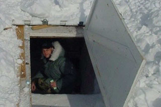 Chief Warrant Officer 5 Christopher Finch performs a food stores inspection at a research camp in Antarctica.
