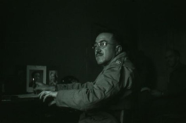 Ralph W. Hammett sits at a desk during World War II. At this time Hammett held the rank of captain.