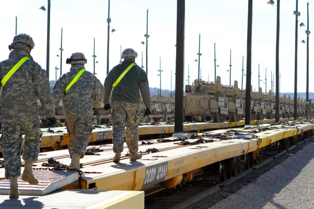 Soldiers from 2nd Battalion, 20th Field Artillery Regiment, Task Force Pegasus Fires, prepare to guide vehicles onto flat train cars at the Fort Hood�'s railhead, Jan. 30. The battalion is preparing vehicles for shipment to the National Training Center at Fort Irwin, Calif. (U.S. Army photo by Sgt. Garett Hernandez, Task Force Pegasus Fires Public Affairs).
