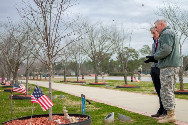 Secretary of the Army John McHugh visits Fort Stewart's Warrior's Walk with 3rd Infantry Division Commander Maj. Gen. John Murray, during a visit to Fort Stewart, Ga., Feb. 11, 2014. McHugh paused to pay his respects to the tree dedicated to Medal of Honor recipient Sgt. 1st Class Paul R. Smith, as well as the other 468 fallen heroes honored along the memorial.