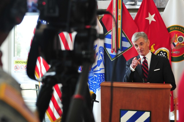 Secretary of the Army John McHugh speaks to local media about the Army's accelerated force reduction and reorganization plans, Feb. 11, 2014, at Fort Stewart, Ga. The original timetable to begin downsizing forces was 2017, but has since been moved up to 2015. This change and how it impacts families and the civilian workforce, specifically at Fort Stewart, should be minimal, according to McHugh.