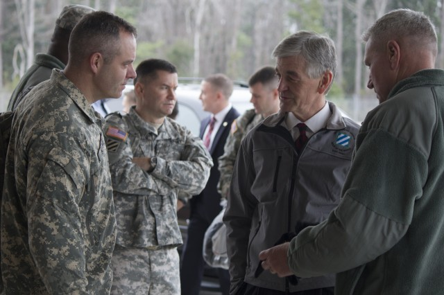 Secretary of the Army John McHugh is introduced by 3rd Infantry Division commanding general Maj. Gen. John M. Murray, to Col. John D. Kline, commander of the 3rd Combat Aviation Brigade at Hunter Army Airfield, Ga., Feb. 11, 2014. The secretary visited Fort Stewart and elements of the 3rd Combat Aviation Brigade.