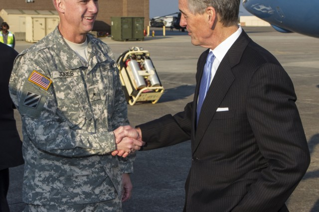 Secretary of the Army John McHugh is welcomed to Hunter Army Airfield by Brig. Gen. Peter L. Jones, 3rd Infantry Division deputy commanding general for support, Feb. 10, 2014. The secretary visited Fort Stewart, Ga., and elements of the 3rd Combat Aviation Brigade.