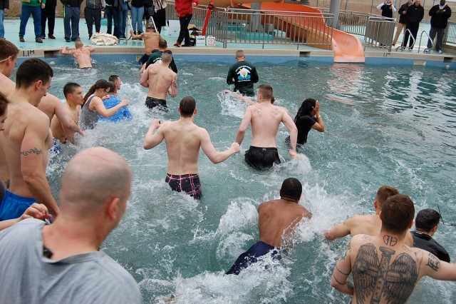 "Altogether, about 350 participants turned out for the �""Freeze Your Buns Run"" five-kilometer fun run and Polar Bear Plunge, at Splish & Splash Waterpark, Feb. 1. Not only were participants able to run, walk, or swim in the pool, but the water slide was also available for the first time. And thanks to Family and Morale, Welfare and Recreation, there was plenty of hot coffee and cocoa to keep everyone warm. Participants also received a black fleece Polar Bear Plunge headband."