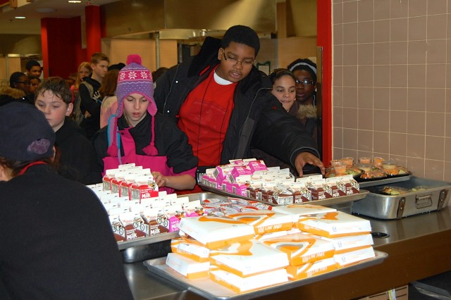 Students from Humphreys Middle/High School eat their lunches at the Talon Café as part of the school lockdown and evacuation exercise Jan. 30.