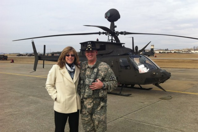 Maj. Gen. Walter M. Golden Jr. (right) and his wife, Joann Golden, stand in front of one of the 4-6th Cavalry Squadron's OH-58D Kiowa Warriors following his final Army flight, on Camp Humphreys, South Korea, Feb. 7, 2014.