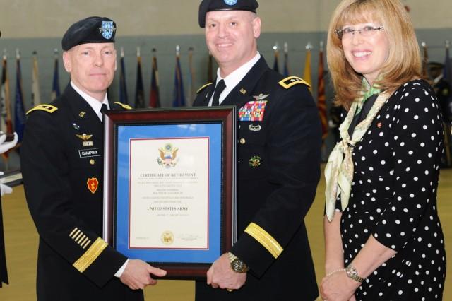 Eighth Army Commanding General Lt. Gen. Bernard S. Champoux (left) presents a certificate of retirement to Maj. Gen. Walter M. Golden Jr. and his wife, Joann Golden, on Yongsan Garrison, South Korea, Feb. 13, 2014.