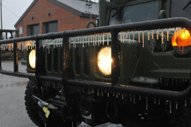 Frozen ice crystals cling to the front bumper of a Georgia National Guard Humvee parked inside the motor pool at the 878th Engineer Battalion Readiness Center in Augusta, Ga. Guardsmen with the 165th Airlift Wing, Georgia Air National Guard prepare to patrol Interstate 20 to provide emergency service and support to civil authorities and to the residents of Georgia hit hard by Winter Storm Pax.