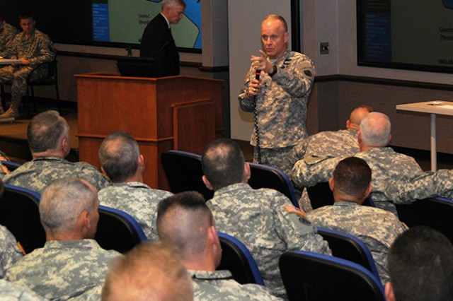Maj. Gen. Kevin W. Mangum, commanding general of the U.S. Army Aviation Center of Excellence and Fort Rucker, speaks during the Aviation Senior Leaders Forum, Feb. 4, 2014 at Fort Rucker.