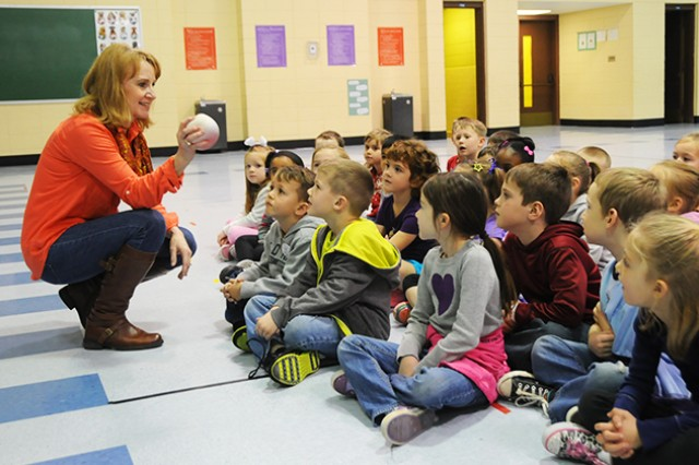 Debbie Doggett, school nurse, demonstrates to Fort Rucker Primary School kindergartners Feb. 5 how the heart is a muscle that keeps the body healthy.