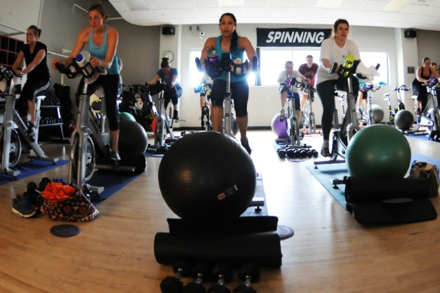 Participants push themselves during a spin class at the Fortenberry-Colton Physical Fitness Center Feb. 10. Classes at both fitness centers count toward the 100-day requirement for the Gym Rats program.