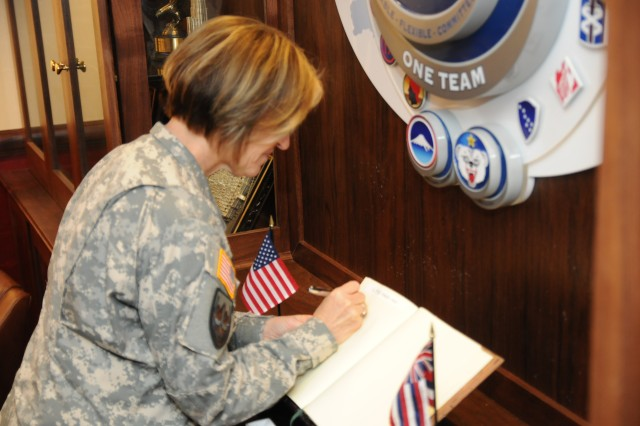 """FORT SHAFTER, Hawaii �"""" Lt. Gen. Patricia Horoho, the surgeon general for the U.S. Army, signs a guest book for Gen. Vincent K. Brooks, commanding general for U.S. Army Pacific before a meeting at the historic Palm Circle located on Fort Shafter, Hawaii Feb. 12. Horoho met with several other commands while she�'s visiting the Pacific region. (U.S. Army photo by Staff Sgt. Kyle J. Richardson, USARPAC PAO)."""