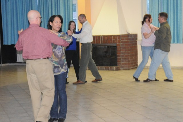 "Participants practice their dance moves at Hohenfels' ""Art of Romance"" couples communication class, recently."