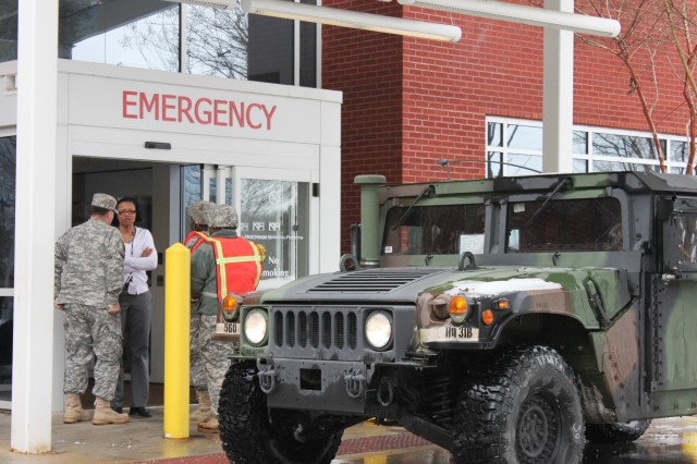 Georgia Guardsmen of the 560th Battlefield Surveillance Brigade transport healthcare professionals to local hospitals in the wake of Winter Storm Pax, Feb. 13, 2014, in Cumming, Ga.