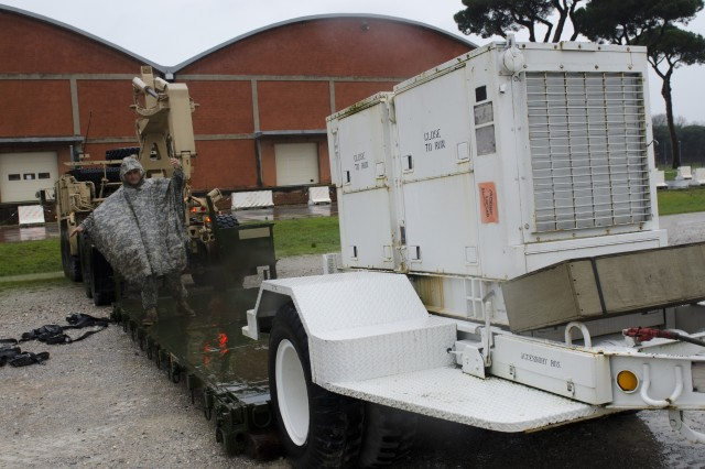 Paratroopers from the 173rd Infantry Brigade Combat Team (Airborne) load up donated generators at Leghorn Army Depot, near Livorno, Italy, Feb. 10, 2014, en route to Slovenia, to assist the Slovenian armed forces after an ice storm.