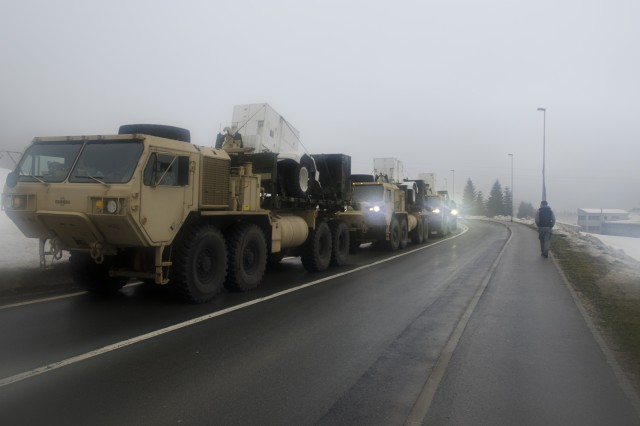 An American-Slovenian convoy waits to deliver generators to ice storm-struck areas near Postojna, Slovenia, Feb. 11, 2014.