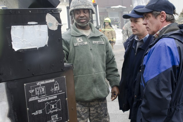 Chief Warrant Officer 2 George Annan, a ground support maintenance technician with the 173rd Infantry Brigade Combat Team (Airborne), familiarizes local electricians with U.S. military generator basics, during a joint convoy to deliver generators to rural villages near Postojna, Slovenia, Feb. 11, 2014.