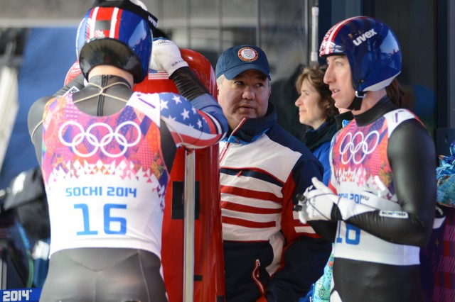 U.S. Army World Class Athlete Program and Team USA luge coach Staff Sgt. Bill Tavares (center) talks with WCAP  Utah National Guard Sgt. Preston Griffall (right) and New York Army National Guard Sgt. Matt Mortensen (left) before the first heat of the Olympic luge doubles event, Feb. 12, 2014, at Sanki Sliding Centre in Krasnaya Polyana, Russia. The U.S. Army duo finished 14th in the event.