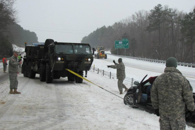 South Carolina National Guard members support the S.C. Department of Public Safety along Interstate 26 looking for stranded motorists, Feb. 12, 2014, in the wake of Winter Storm Pax, as The Weather Channel called the storm.