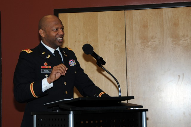 Maj. Terry Saul of First Army addresses the audience at the Martin Luther King Jr. Center in Rock Island, Ill., on Feb. 13 The center was hosting a luncheon celebrating the contributions of African-American veterans and their families.