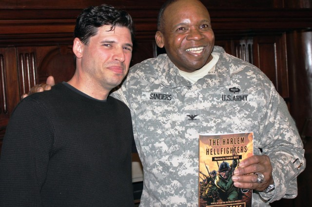 "New York Times bestselling author Max Brooks, and New York Army National Guard Col. Reginald Sanders, commander of the 369th Sustainment Brigade, with a copy of Brook's new graphic novel, ""The Harlem Hellfighters."" The book tells the story of the all-black New York National Guard infantry regiment which fought under French command in World War I and earned more than 170 medals for heroism. Brooks, author of ""World War Z,"" the fictional story of mankind's fight against zombies, visited the Harlem Armory on Feb. 6,  to talk with Sanders about the history of the unit for a National Public Radio book show."