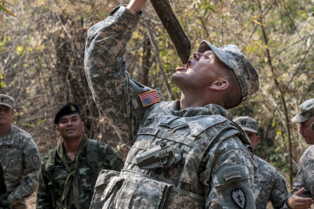 Brig. Gen. Todd McCaffery drinks fresh water from a vine local to Thailand during Jungle Survival Training at Ban Dan Lan Hoi, Thailand as part of Exercise Cobra Gold 14, Feb. 15.