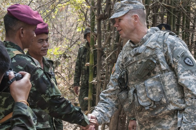 Brig. Gen. Todd McCaffery, deputy commanding general, 25th Infantry Division, meets with Royal Thai Army Special Forces Instructor, Master Sgt. Sangchai Seeuthai during jungle survival training. Jungle Survival Training is part of ongoing operations during Exercise Cobra Gold 2014.
