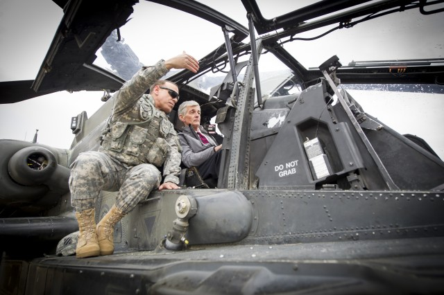 Secretary of the Army John McHugh receives an orientation to an AH-64 Apache helicopter at Fort Stewart, Ga., Feb. 11. 2014.