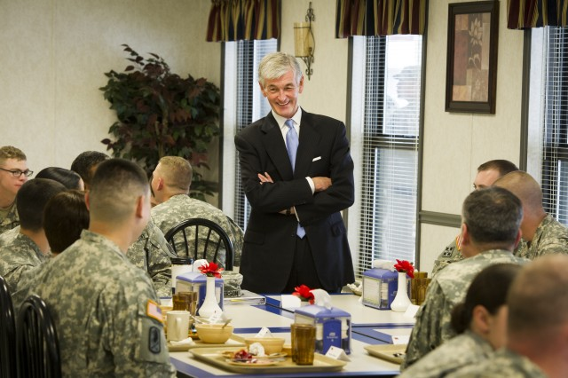 Secretary of the Army John McHugh speaks with U.S. Army Signal Center of Excellence Soldiers during lunch at Fort Gordon, Ga., Feb. 10, 2014.