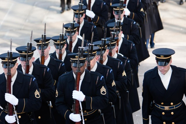 Members of the 3d U.S. Infantry Regiment (The Old Guard), Joint Base Myer-Henderson Hall, march toward the Tomb of the Unknowns in Arlington National Cemetery, Arlington, Va. Feb. 11, 2014 before the start of a state visit wreath-laying ceremony. Francois Hollande, president of the French Republic, laid a wreath at the Tomb of the Unknowns with Chuck Hagel, secretary of defense, and Maj. Gen. Jeffrey S. Buchanan, Joint Force Headquarters-National Capital Region and Military District of Washington commanding general.