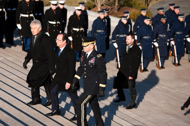 From left, Chuck Hagel, secretary of defense, Francois Hollande, president of the French Republic; and Maj. Gen. Jeffrey S. Buchanan, Joint Force Headquarters-National Capital Region and Military District of Washington commanding general, approach the Tomb of the Unknowns in Arlington National Cemetery, Arlington, Va. Feb. 11, 2014. Hollande laid a wreath at the tomb and awarded the French Legion of Honor Medal to the World War II Unknown Soldier buried in the tomb.