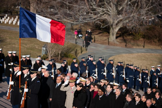 Members of the 3d U.S. Infantry Regiment (The Old Guard), Joint Base Myer-Henderson Hall, hold the French flag during a wreath laying ceremony at the Tomb of the Unknowns in Arlington National Cemetery, Arlington, Va. Feb. 11, 2014. Francois Hollande, president of the French Republic, laid a wreath at the Tomb of the Unknowns with Chuck Hagel, secretary of defense, and Maj. Gen. Jeffrey S. Buchanan, Joint Force Headquarters-National Capital Region and Military District of Washington commanding general.