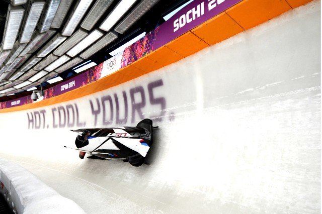 U.S. Army Sgt. Nick Cunningham, the bobsled driver, and Army Sgt. Dallas Robinson, the brakeman, are clocked at 81.4 mph as the seventh-fastest among 30 sleds in the second heat of Olympic two-man bobsled training with a time of 57.19 seconds at Sanki Sliding Centre in Krasnaya Polyana, Russia, Feb. 13, 2014. Cunningham, a New York National Guardsman, and Robinson, a Kentucky National Guardsman, are assigned to the U.S. Army World Class Athlete Program.