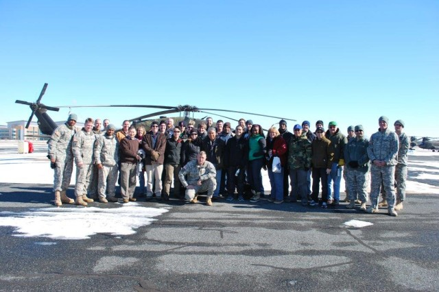 Shown are the greening course participants, the NCOs who coordinated the event and the crew from the Maryland Army National Guard, posing in front of the UH 60 Blackhawk helicopter.
