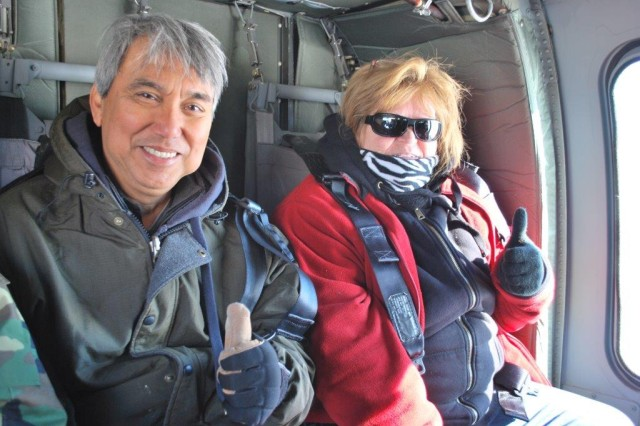 Shown are Manny Diego, STTC, and Donna Bumba, from laboratory operations, while on their UH 60 Blackhawk helicopter ride that was provided by the Maryland Army National Guard.
