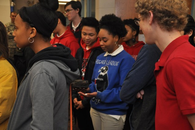 Jenkins High School students pass around a rock while learning about geology during a visit by the U.S. Army Corps of Engineers, Feb. 13, 2014. The visit aimed to recruit students to pursue science and engineering related career paths as part of National Engineers Week.