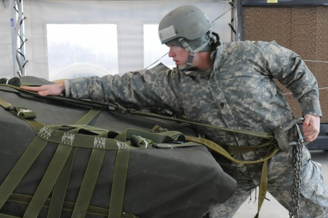 Spc. Stephen Ramunno, a student of Fort Hood's Air Assault class 05-14, inspects an A22 cargo bag, Feb. 7, 2014, during the phase two test on sling load operations at Fort Hood, Texas. Students are required to know how to rig loads to rotary wing aircraft and identify any deficiencies during testing.