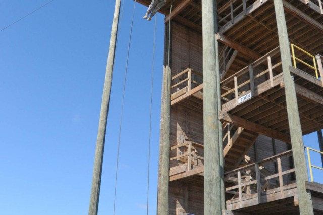 A student in the third phase of the Fort Hood, Texas, Air Assault School class 05-14, rappels down the 50-foot tower, Feb. 12, 2014. Rappelling down the tower is a part of the overall grade the students receive.