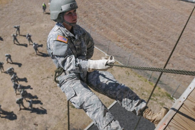 Pfc. Olivia Newberry, a student of the Fort Hood, Texas, Air Assault School class 05-14, prepares to rappel down the 50-foot tower, Feb. 12, 2014, as a part of her graded portion of phase three. This marks the first of many rappels for Newberry during the training.