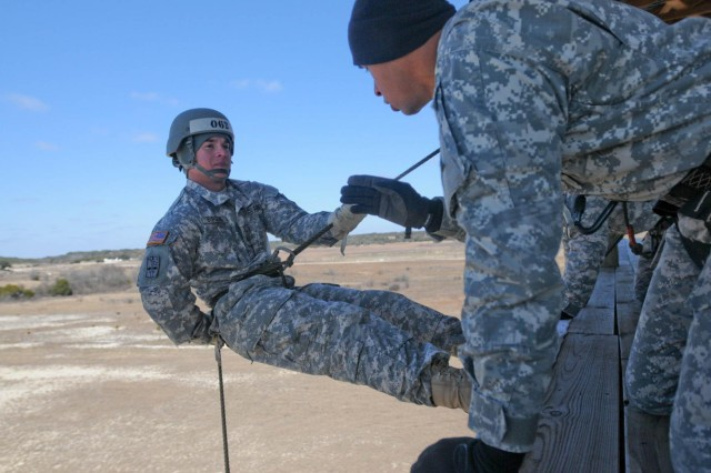 Sgt. Jon Garcia (right), from Hattiesburg, Miss., instructs Sgt. Christopher Burgess, a student in the third phase of the Fort Hood, Texas, Air Assault School class 05-14, Feb. 12, 2014, on what lane to stay in during testing on repel operations. Attention to detail is important during the course to ensure safety at all times.