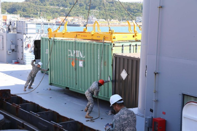 Soldiers from the 97th Transportation Company work to load 31 containers during port operations for Pacific Utilities and Logistics Support Enablers - Watercraft exercise Jan. 24 at White Beach Naval Base, Okinawa, Japan. This represents the first time U.S. Army watercraft assets will be used in support of exercises Cobra Gold and Balikatan for an extended period of time and could save valuable taxpayer resources.